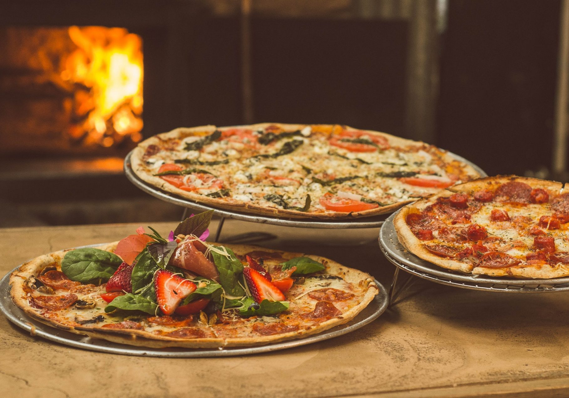 shallow-focus-photography-of-several-pizzas-1566837